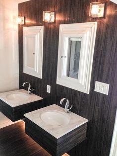 Vinyl plank  floor installed on wall Bathroom double vanity  Dark floors Modern bathroom Light fixture Retro light