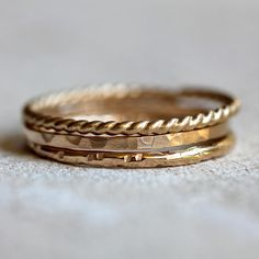 14k gold stacking rings. This set of three stacking ring are of various texture and design. These unique solid 14k yellow gold stacking rings make a unique wedding ring or a set of awesome everyday ri