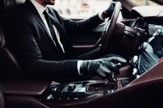 Male Model in Suit and Gloves Driving DS Spirit