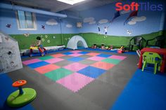 This was your typical basement room- lots of concrete, but now it's a fun basement playroom, created with SoftTiles 2x2 Interlocking Foam Mats.