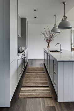 Calm and cool by Tania Handelsmann// kilim runner, industrial pendant lights, gray kitchen