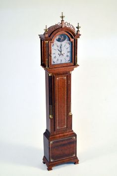 A GORGEOUS REAL WALNUT GRANDFATHER CLOCK SIGNED GERALD CRAWFORD AND NICOLE WALTON MARBLE. THIS IS SUCH AN INCREDIBLE PIECE ITS HARD TO EVEN DESCRIBE. FABULOUS FINE FRETWORK AT THE TOP WITH 3 BRASS SPIRES.   eBay!