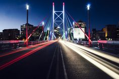 The Nelson Mandela Bridge is a bridge in Johannesburg, South Africa. It was completed in 2003 with a million price tag. Bring The Heat, Bring It On, Entertainment Blogs, Nelson Mandela, Golden Gate Bridge, South Africa, African, Entertaining, Bridges