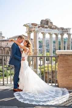 Bride and groom at the Roman Forum in #Rome Italy with #weddingdress fanned out. #Wedding photography by Andrea Matone. www.andreamatone.com
