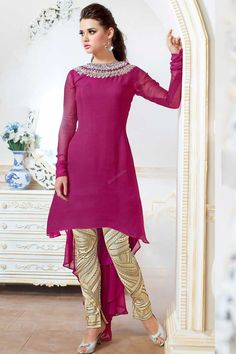 Pink Georgette, semi stictch trouser suit.   Round neck, Above knee length, full sleeves kameez.   Cream santoon trouser.   Pink chiffon dupatta.  It is perfect for bridal wear, casual wear, festival wear and party wear wear.  Andaaz Fashion is the most popular designer wear online ethnic shop brands.  http://www.andaazfashion.us/salwar-kameez/trouser-suits/occasion/festival-wear-trouser-suit