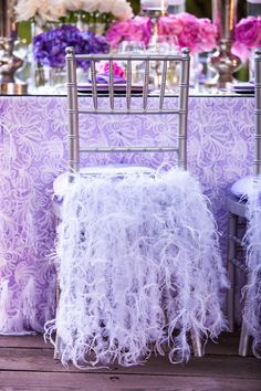 Pretty lavender feathers chairs for a purple wedding