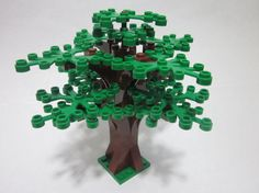 Add a forest tree to your LEGO City!  This custom designed LEGO forest tree is built with 14 green leaves and stands almost 5 inches tall.