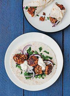 Spicy lamb kofta kebabs wiht yogurt and salad