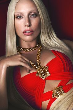"As per her current aesthetic, Lady Gaga features a gold necklace in this image for Versace. While this image overlaps somewhat with fashion, she as a singer also promotes the idea of being royal, also seen in her latest music video for ""G.U.Y"". (observation)"