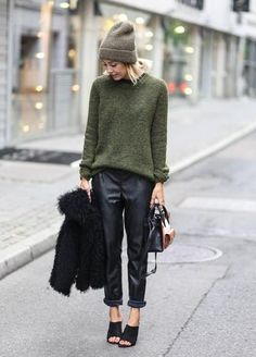 the knit beanie and olive green sweater adds a cozy touch to these baggy leather pants and mules