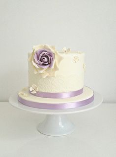 Lilac Vintage Cake. A pretty vintage cake decorated with lace, blossoms and a single handmade sugar rose. The cake was a coffe mocha filled with a rich coffee ganache.