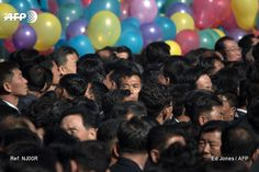 Attendees wait for the opening ceremony for the Ryomyong Street housing development in Pyongyang on April 13, 2017. Completion of the sprawling Ryomyong Street development, just down a wide avenue...