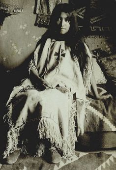 Daughter of Geronimo c.1900. - Lena Geronimo was born in 1886 in Fort Marion, St. Augustine, FL, while her father was a prisoner there. The medical staff gave her the name Marion, after the fort, but she took the name Lenna upon returning to the Southwest. Lenna Geronimo, the daughter of Geronimo and wife Ih-tedda, a Mescalero Apache, was the full sister of Robert Geronimo, Geronimo's only living son. Lenna was Bedonkohe-Mescalero.