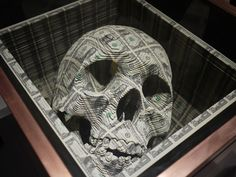 Skull carved into $11,000 in cash -- wow.