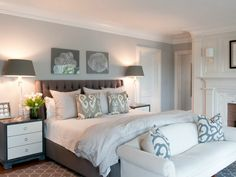 Coastal bedroom with upholstered headboard.... I love that this room is bright and light even with a big dark colored bed!