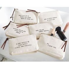 "Heavy canvas multi-use pouches feature leather zipper pulls and black printed sentiments: 4x7 ""THOUGH SHE IS BUT LITTLE SHE IS FIERCE,"" ""ADD A LITTLE SPARKLE TO EACH DAY,"" ""A GIRL SHOULD BE TWO THINGS"