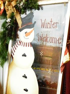 C & C Furnishings - hand painted snowman on old window