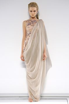 Chanel Fall 2009 Couture: Roman toga and/or paludamentum with pinning at one shoulder.