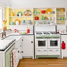 A Cheery Bungalow Redo Stays True to Form A O'Keefe & Merritt stove, vintage-green dishwasher, and salvaged-beadboard cabinet doors keep this bungalow kitchen true to its past. Vintage Chic, Vintage Design, Retro Vintage, Vintage Green, Shabby Vintage, Modern Retro, Vintage Stuff, Danish Modern, Vintage Decor
