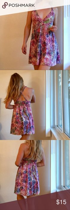 Sun Dress Pretty sundress, makes a great swimsuit cover up or everyday wear. Flowy and flattering! Best with a cute brallette or bikini top because of the low cut and most bras will show at the front. Gently used, excellent condition. Xhilaration Dresses Mini