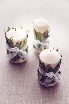 Candle idea for wedding table centre made with fresh natural eucalyptus (BridesMagazine.co.uk)