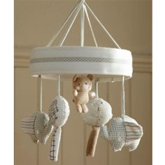 Natures Purest Teddy and Ele Musical Cot Mobile (£30.95) - Two elephants and trees rotate to the sound of rock-a-bye baby watched by a sweet little teddy. This makes a wonderful #babygift.
