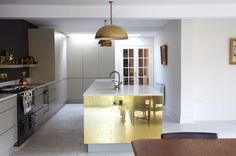 mirrored gold kitchen panel to increase light in dark room