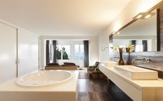 Large Oval Soaking Tub Across From Double Vanities