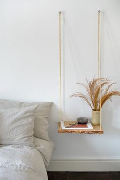 This DIY hanging nightstand will free up valuable floor space, making it a perfect solution for smaller spaces. Plus, it's also a great way to update your decor on a budget. Room Ideas Bedroom, Diy Room Decor, Bedroom Decor, Diy Ideas For Bedroom, Art For Bedroom, Americana Home Decor, Country Decor, Diy Nightstand, Floating Nightstand