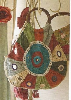 -This lined colourful crochet bag with inset mirrors is 52cm long ...