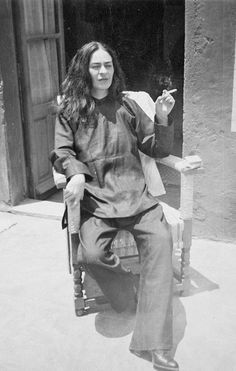smoking a cigarette and dressed down in slacks this intimate photo shows a rare glimpse into the private life of artist frida kahlo.