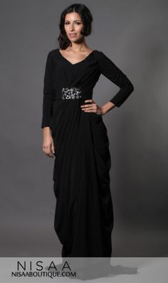 Raven- A truly exquisite black draped gown perfect for any extra special occasion. The Raven Dress features dazzling beading of silver and black gems in the waist line.