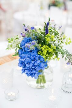 Coastal blue wedding in West Sussex. Blue wedding flowers in jars  Photography www.annelimarinovich.comA COASTAL TWIST