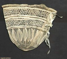"""Both knotted linen thread & w/ original silk ribbon drawstrings: 1 reticule worked in 2 thicknesses of linen thread, 8.5"""" x 9"""", (1 stain); 1 pair elbow-length gloves, L 15"""", (stains on fingertips); t/w 2 pair American mitts: 1 pair 18th C linen; 1 pair cable-knit ecru cotton; very good-excellent."""