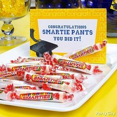 Smarty pants! A simple little sign turns Smarties® into clever graduation party treats. :) by amelia