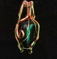 Apache Tear Obsidian wire wrap pendant on etsy.com by The Crystal Pyramid $12.99