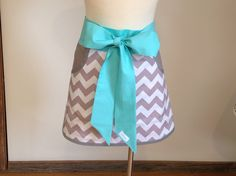 Gray Chevron trimmed with teal ties.