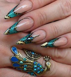 Turquoise stilettos and gold leaf nail art...creepy but cute. It's an art thing.