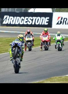Valentino Rossi wheelies in front of stefan bradl,  cal crutchlow and Alvaro Bautista doing practice starts at le mans 2014