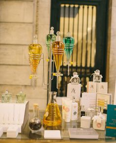 """""""The five senses theme also featured a scent station (which also doubles as the perfect personalized favor!). Guests create their own signature perfume or cologne and get to smell all the different scents. Vintage chemistry equipment is the perfect way to display all the colorful scent oils too!"""""""