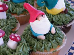 Gnome and Toadstool Cupcakes in vanilla, chocolate and carrot flavors.