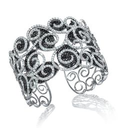 Black and White Diamond Scroll Cuff - Black and white diamond pave open scroll motif cuff bracelet. Set in 18-karat white gold with over 20 carats of diamonds. / Cellini Jewelers