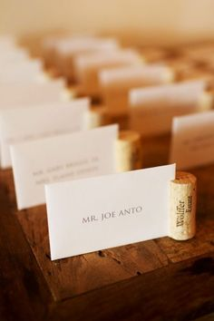 Another way to do Wine Cork Wedding Place Card Holders. Probably stand up better than when you put the cork on the bottom! Wine Cork Wedding, Wedding Table, Cork Place Cards, Party Planning, Wedding Planning, Wedding Places, Wedding Pins, Wedding Blog, Cork Crafts