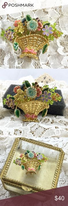 Vintage Multi Flower Gold Tone Basket Brooch Nine different enamel flowers in a detailed gold tone basket with a pink bow and two green enamel leaves.  In the background are clear green glass wired beads.  Amazing!!! Vintage Jewelry Brooches