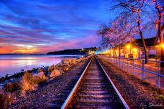 Train tracks on the beach at night
