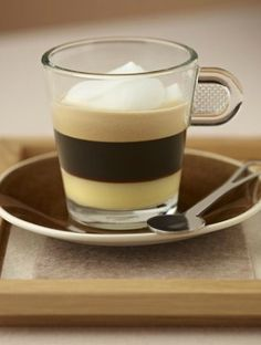 White Chocolate Coffee | If you love Nespresso's Roma Grand Cru, check out this quick and easy coffee recipe that includes a layer of white chocolate syrup and a  frothy cream topping.