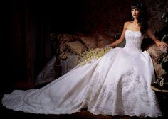 Eve of Milady gown, Style unknown.Beautiful ivory Silk and crystal beaded ball gown with a french cut tail.