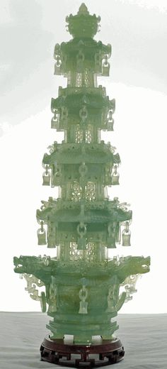 Chinese Carved Green Jade Pagoda - This carved green jade Buddhist pagoda is made of authentic jade, probably Nephrite or possibly Jadeite. It was carved in approximately 1960 and purchased in China by one of the earliest collectors to have access to China during the Mao Era.   This traditional Chinese style Buddhist five-level pagoda has eight bells at each level, hanging from the corners of the octagonal roofs.