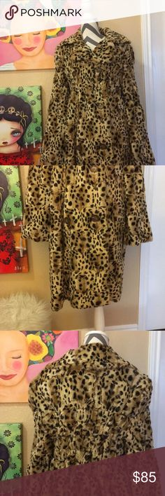 Vintage faux fur leopard print coat. Vintage faux fur leopard print coat that I bought in Santa Barbara on State St. From a vintage store. Simply gorgeous and feels luxurious and around the waist it has stretch which makes it even more comfortable. It's by Excelled Collection in a size M. Excelled Collection Jackets & Coats