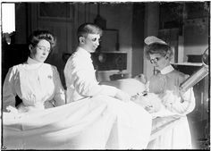 Radium Cure; Image of a patient laying on a table or bed receiving a radium treatment administered by three health care workers in Chicago, Illinois. Another patient is visible in the background.; 1903